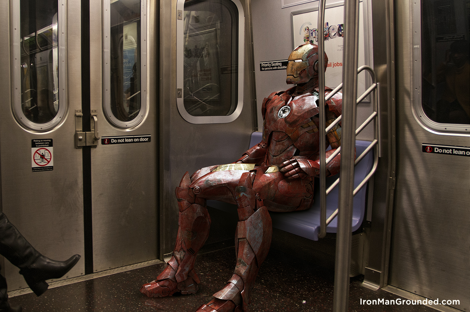 6_iron_man_grounded_rides_new_york_subway_raffael_dickreuter